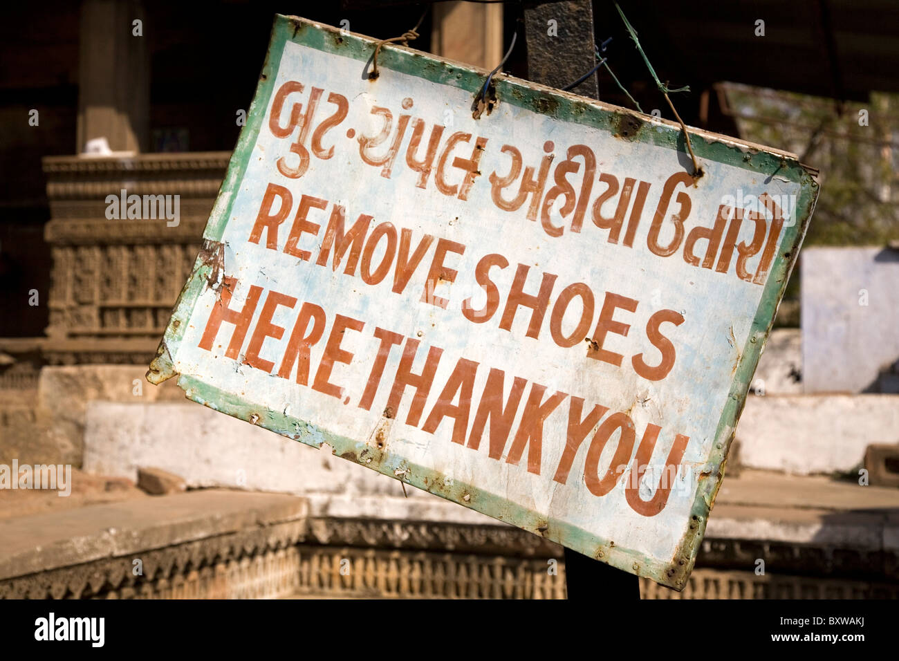 A sign in Gujarati and English tells people to