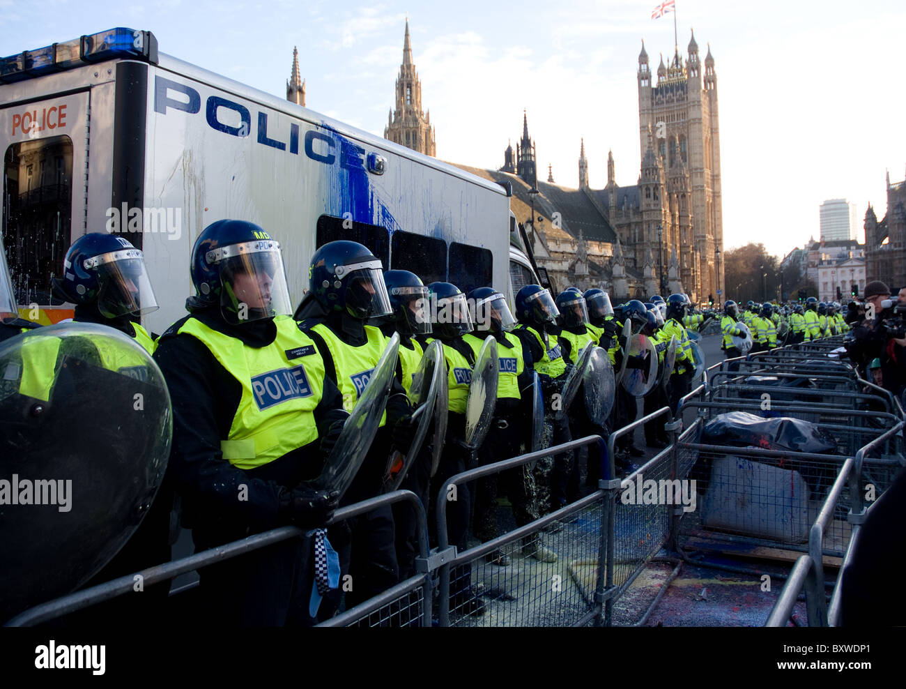 riot police cordon off the houses of parliament during student protests - Stock Image