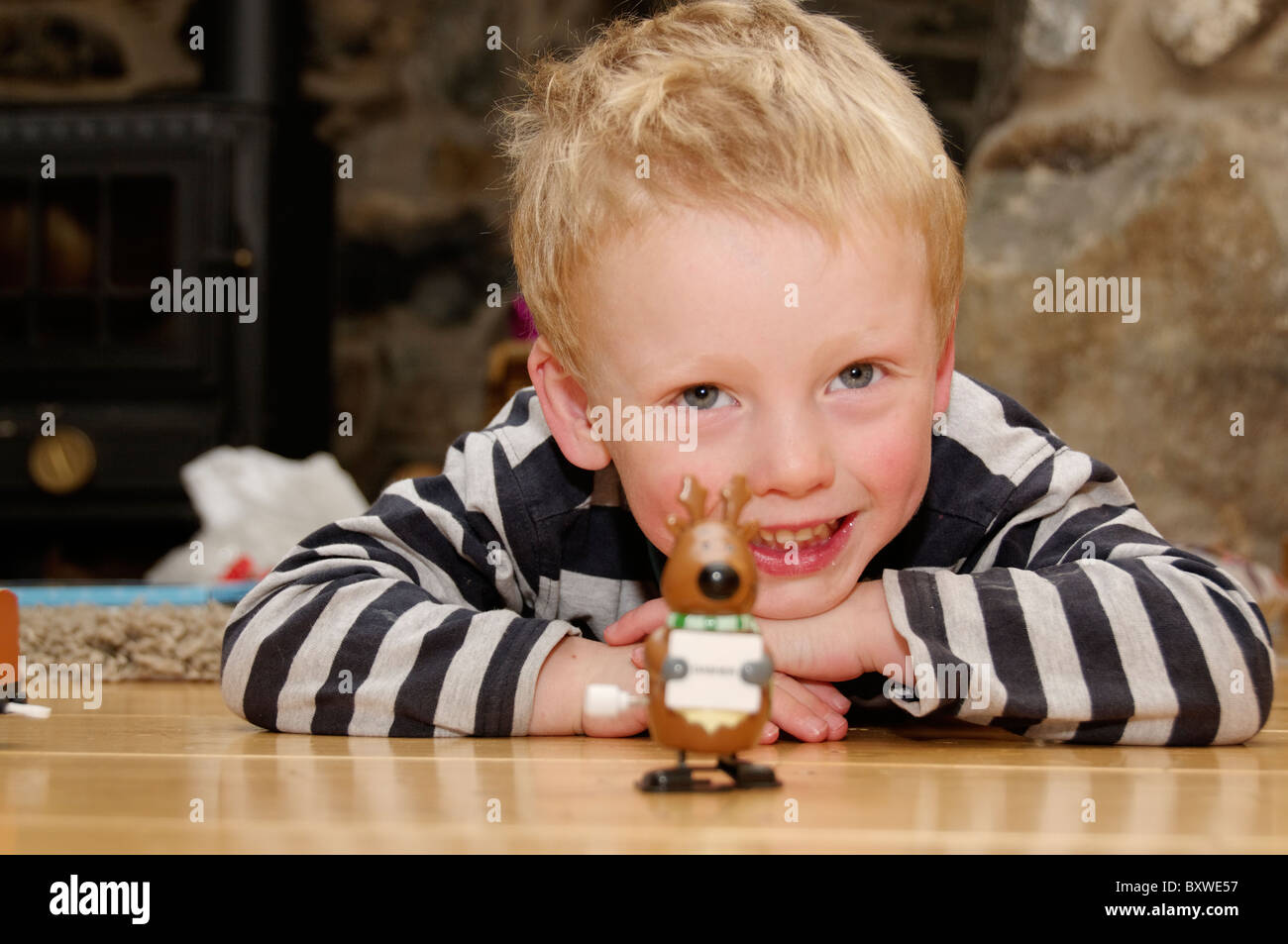 A boy playing with a toy  on Christmas morning - Stock Image