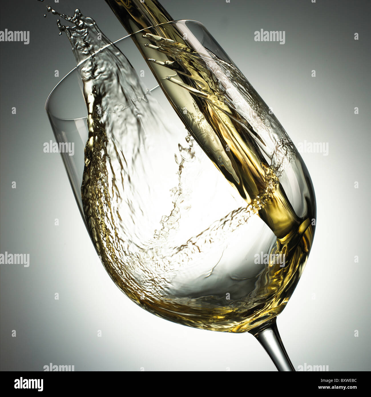 wine being poured into a glass - Stock Image