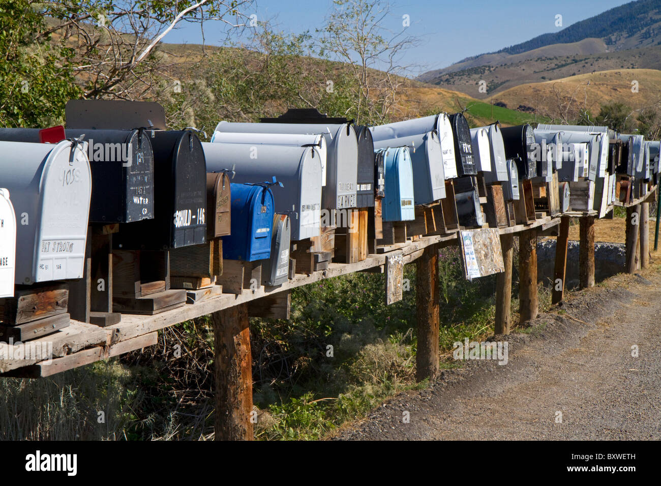 Mailboxes lined up for the delivery of mail in a rural area near Challis, Idaho, USA. - Stock Image