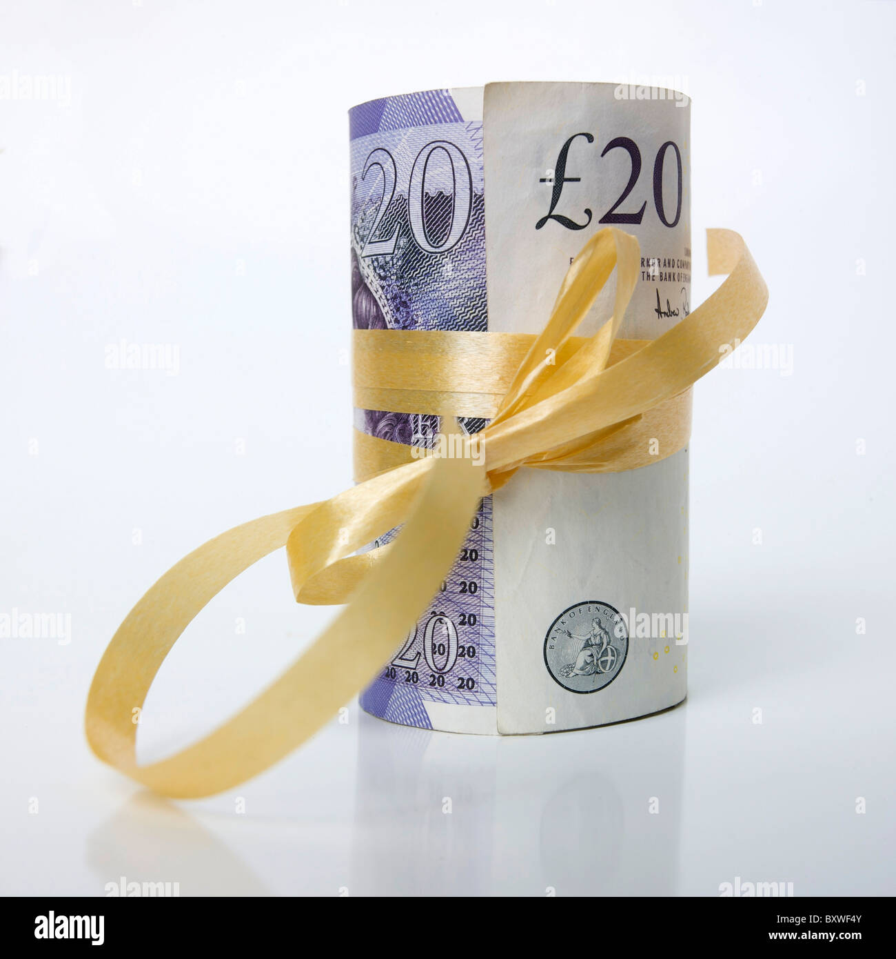 Rolled bunch of banknotes, British / UK pound sterling GBP - money gift / present / savings concept. - Stock Image