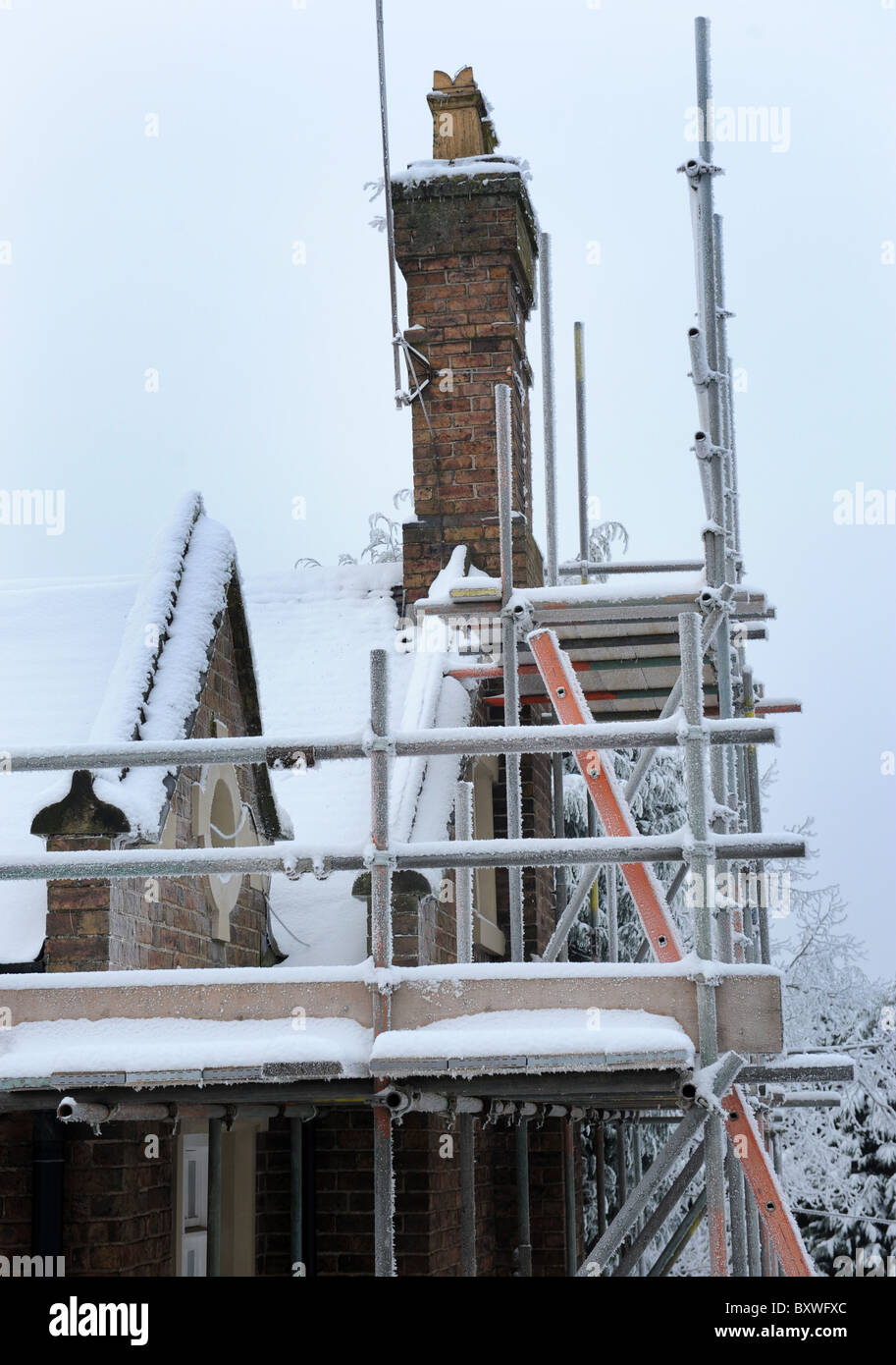 Snow Ice and Frost on scaffolding stops work Stock Photo