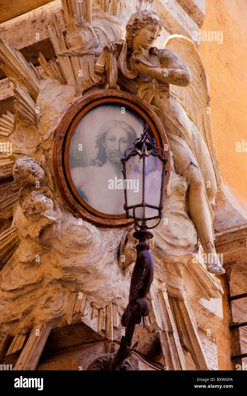 Carved religious shrine on a building corner near Piazza Navona, Rome Italy - Stock Image