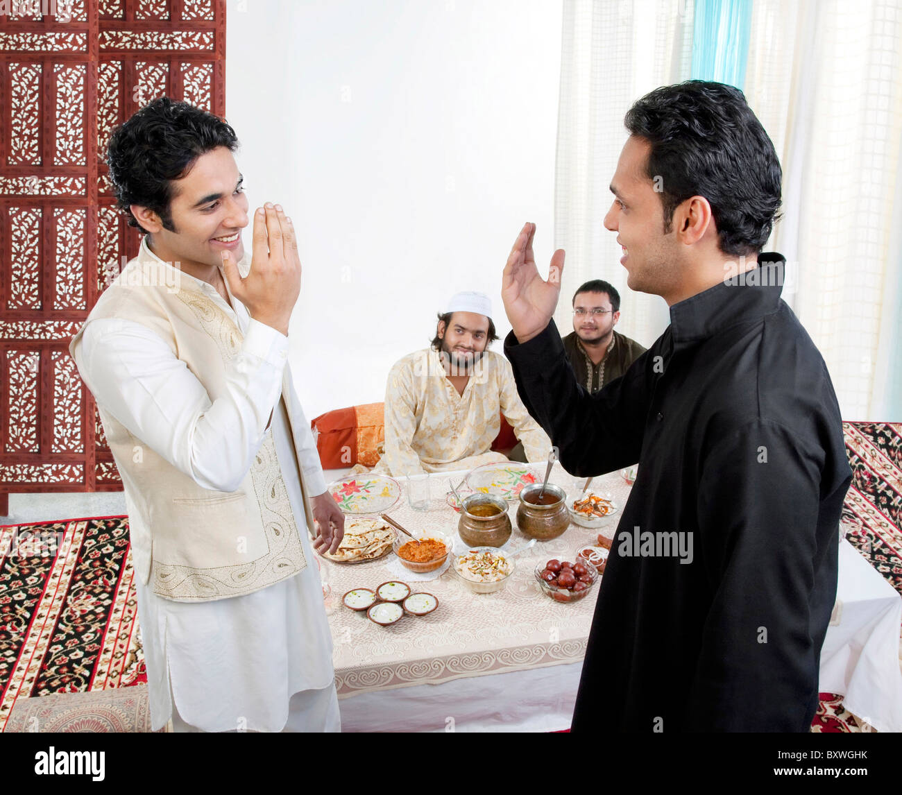 Muslim men greeting each other stock photo 33753263 alamy muslim men greeting each other m4hsunfo