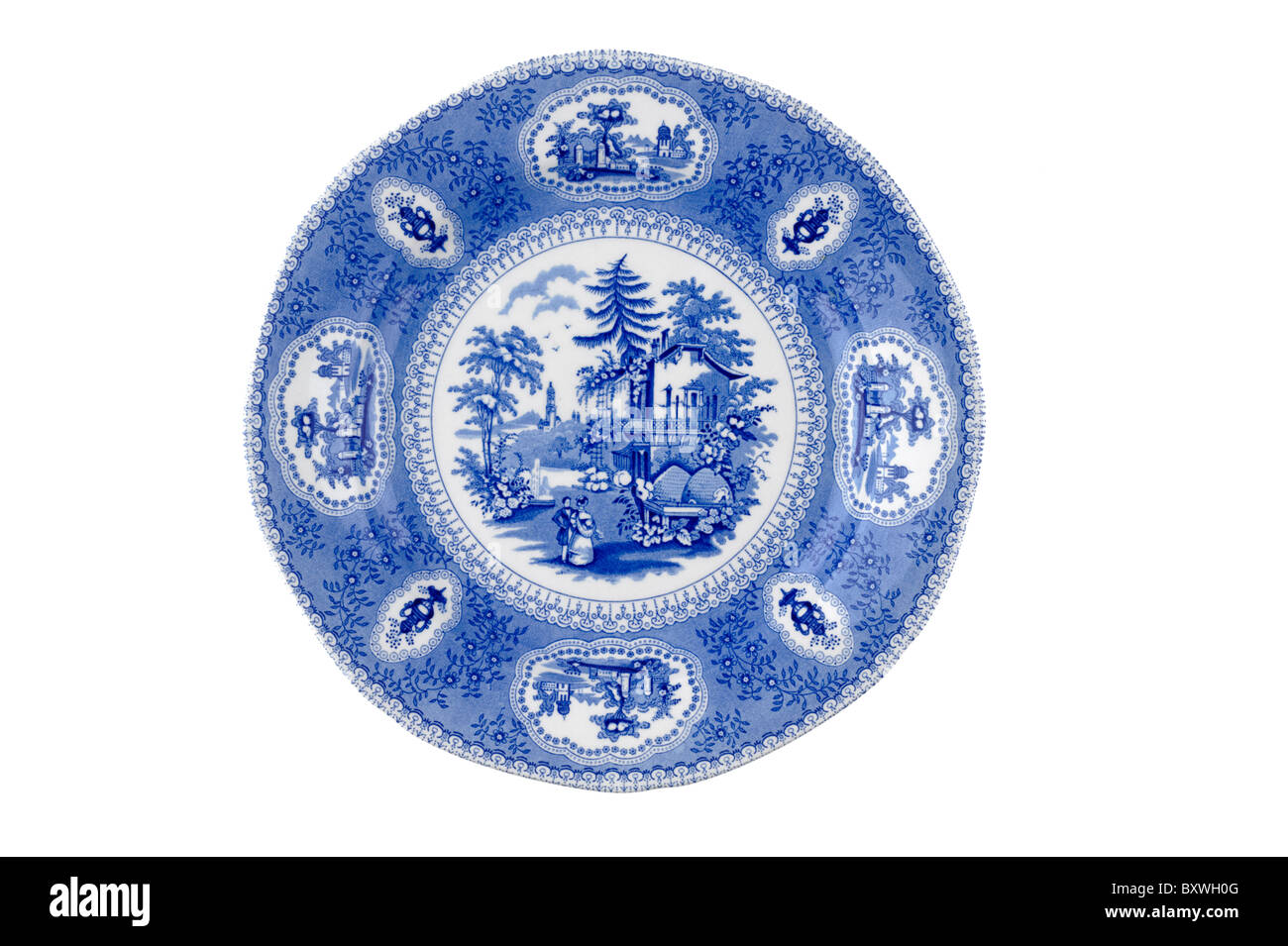 Blue and white patterned plate - Stock Image