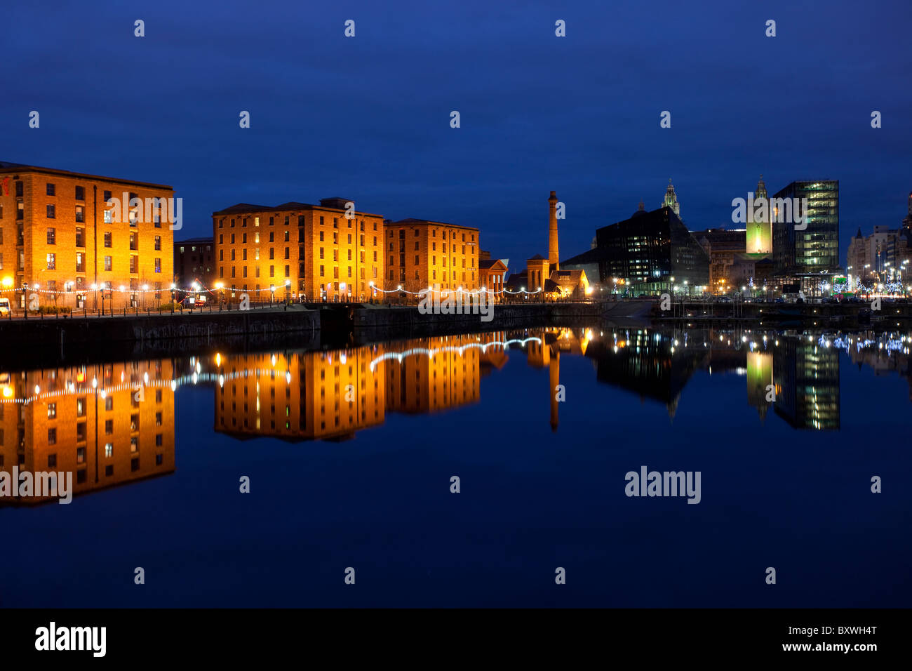The Reflected Buildings of the Albert Dock at Night, Liverpool, Merseyside, Uk - Stock Image