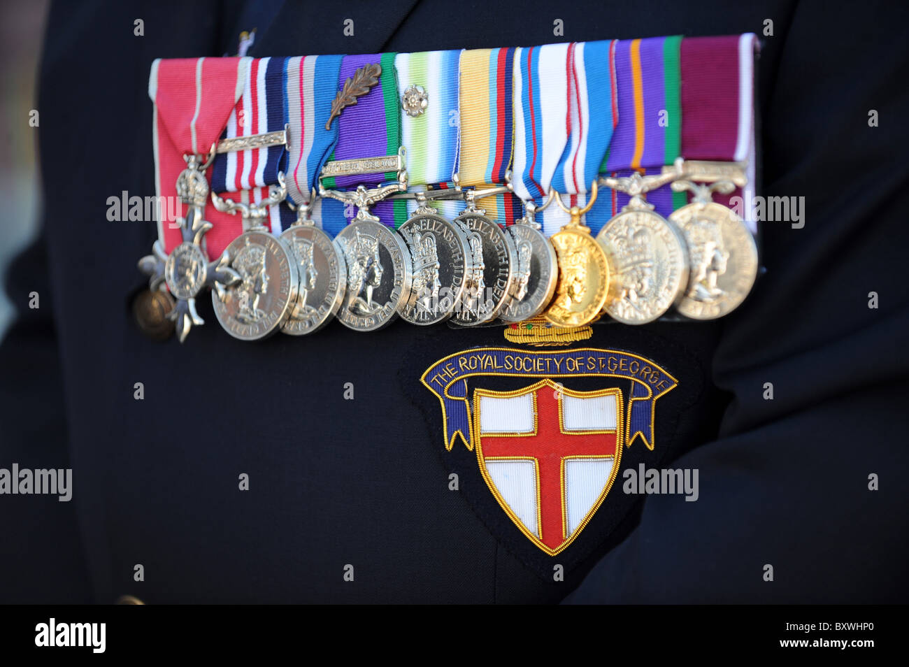 Row of service medals on soldiers dress uniform some awarded in Northern Ireland - Stock Image