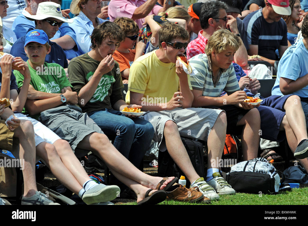 Young cricket fans tuck in to lunch during the match between Sussex and Australia held at the County Ground in Hove Stock Photo