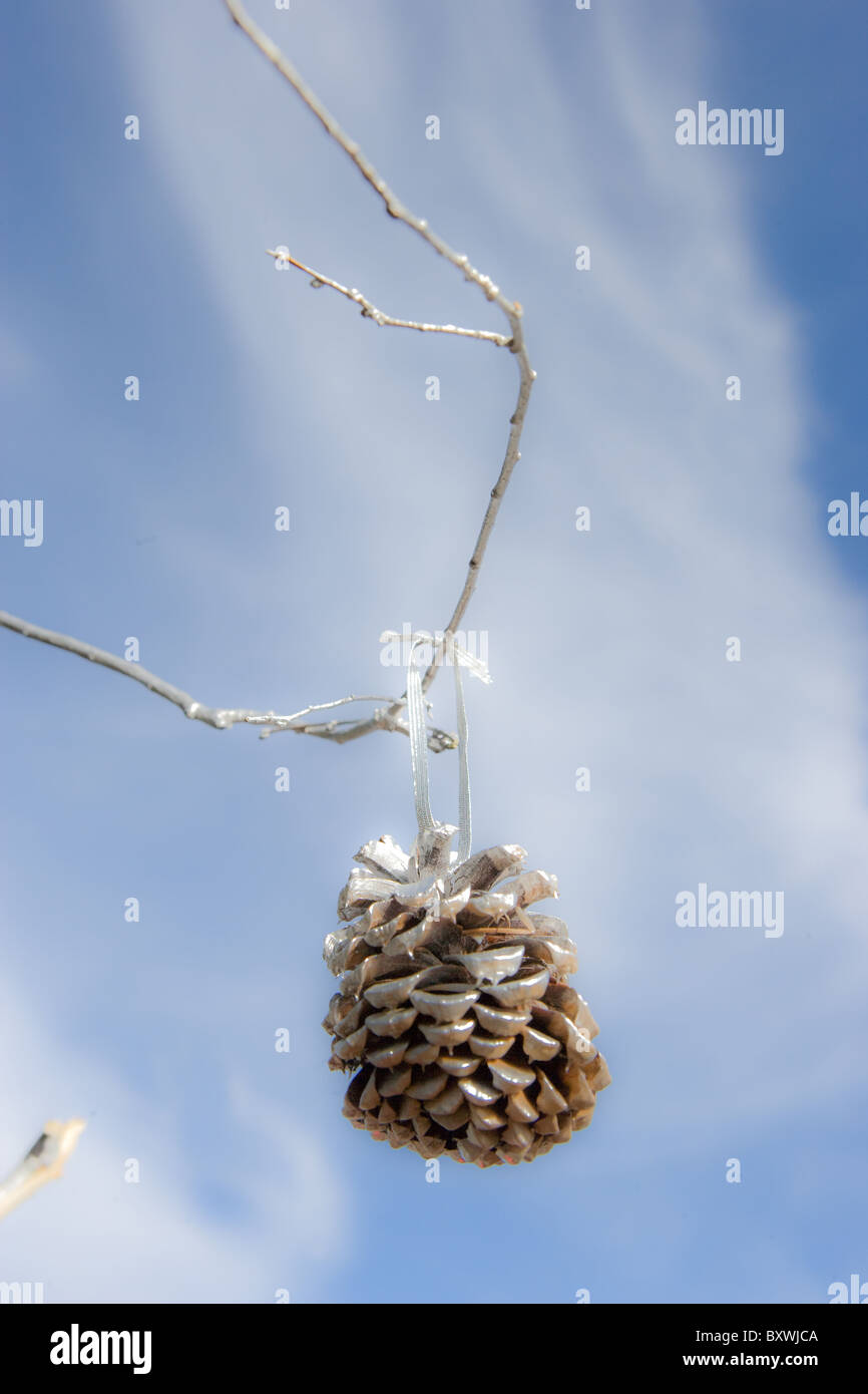 Natural Christmas ornament, pine cone painted with silver paint. - Stock Image