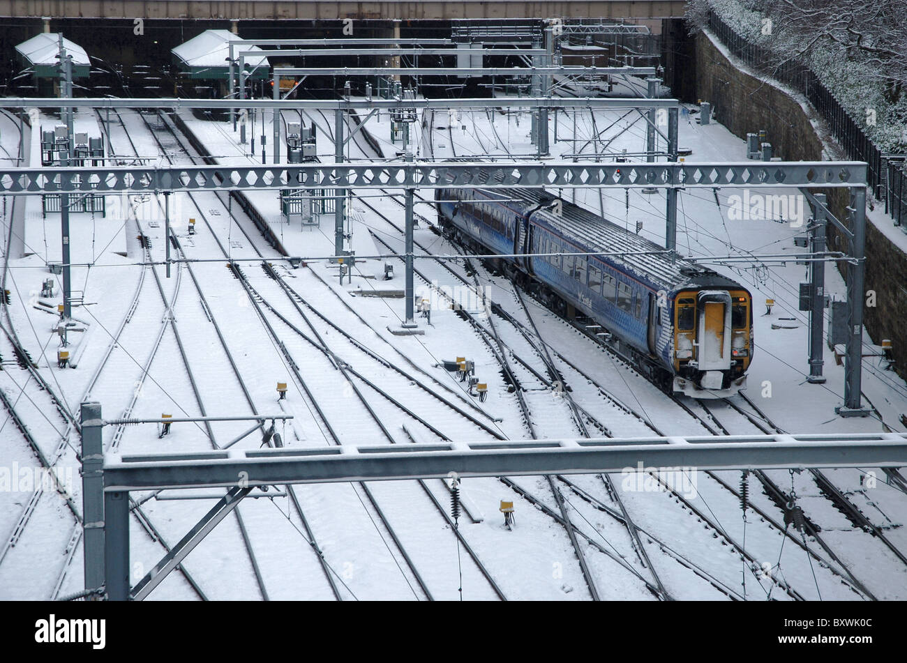A train pulls in to Waverley Station in Edinburgh after a fall of snow. - Stock Image