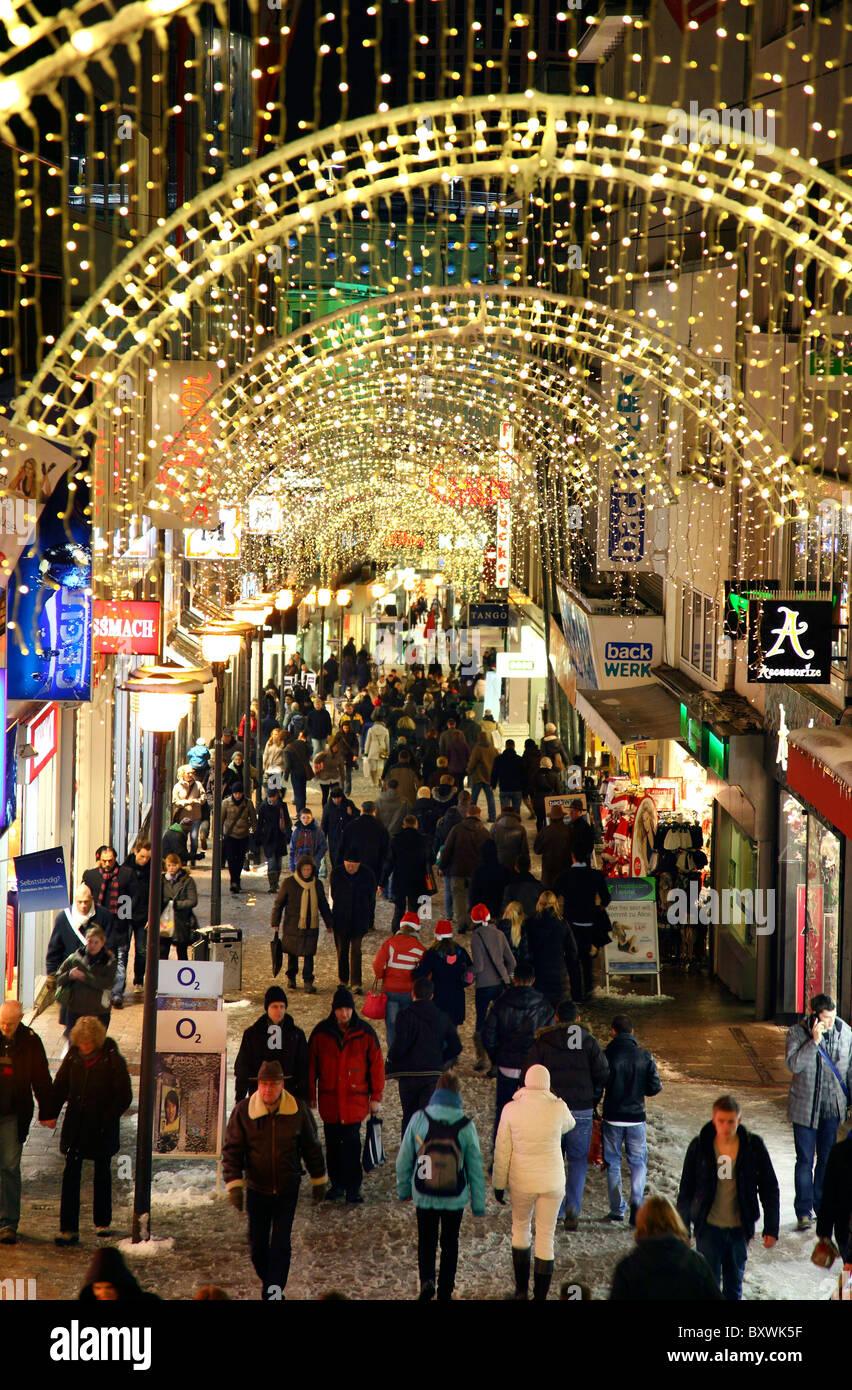 Shopping street, pedestrian area, illumination, people going shopping, Essen, Germany. Stock Photo