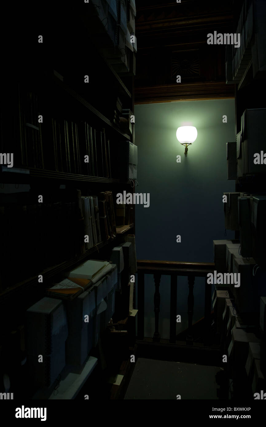 interior of library, book stacks, book shelves, dark, mysterious, library - Stock Image