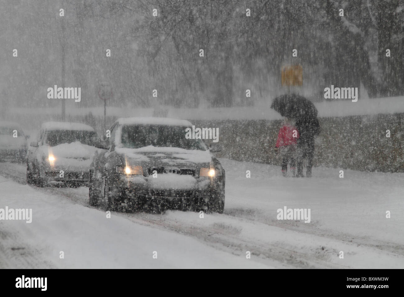 Hazardous dangerous driving conditions winter snow ice blizzard - Stock Image
