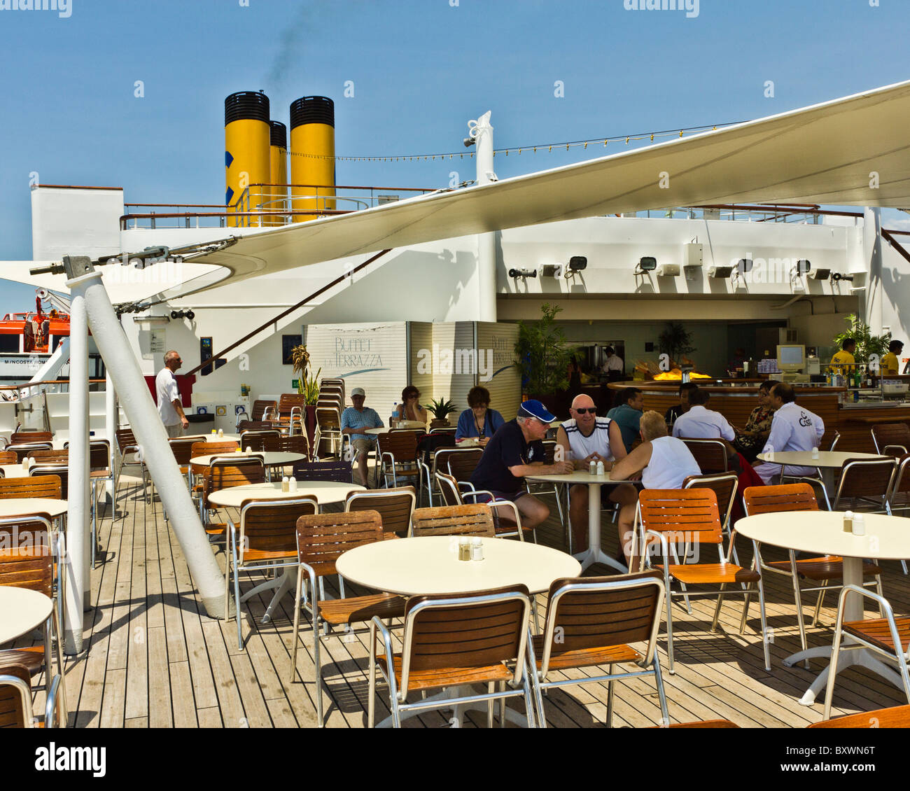 Passengers relaxing at the rear deck bar of Costa Romantica cruise ship - Stock Image