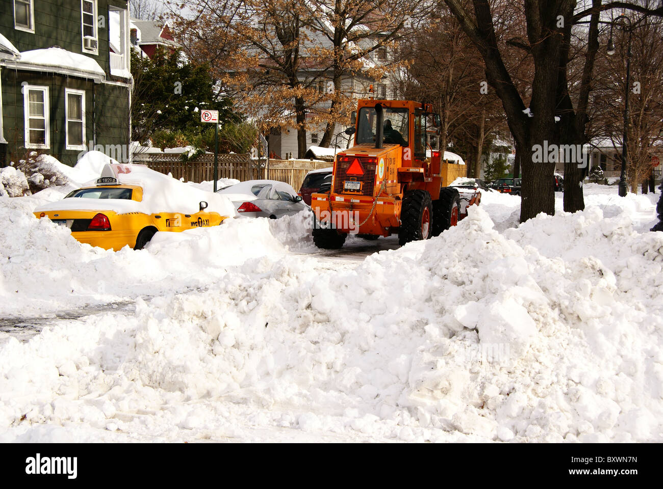 Bulldozer helps in snow cleaning effort in New York - Stock Image