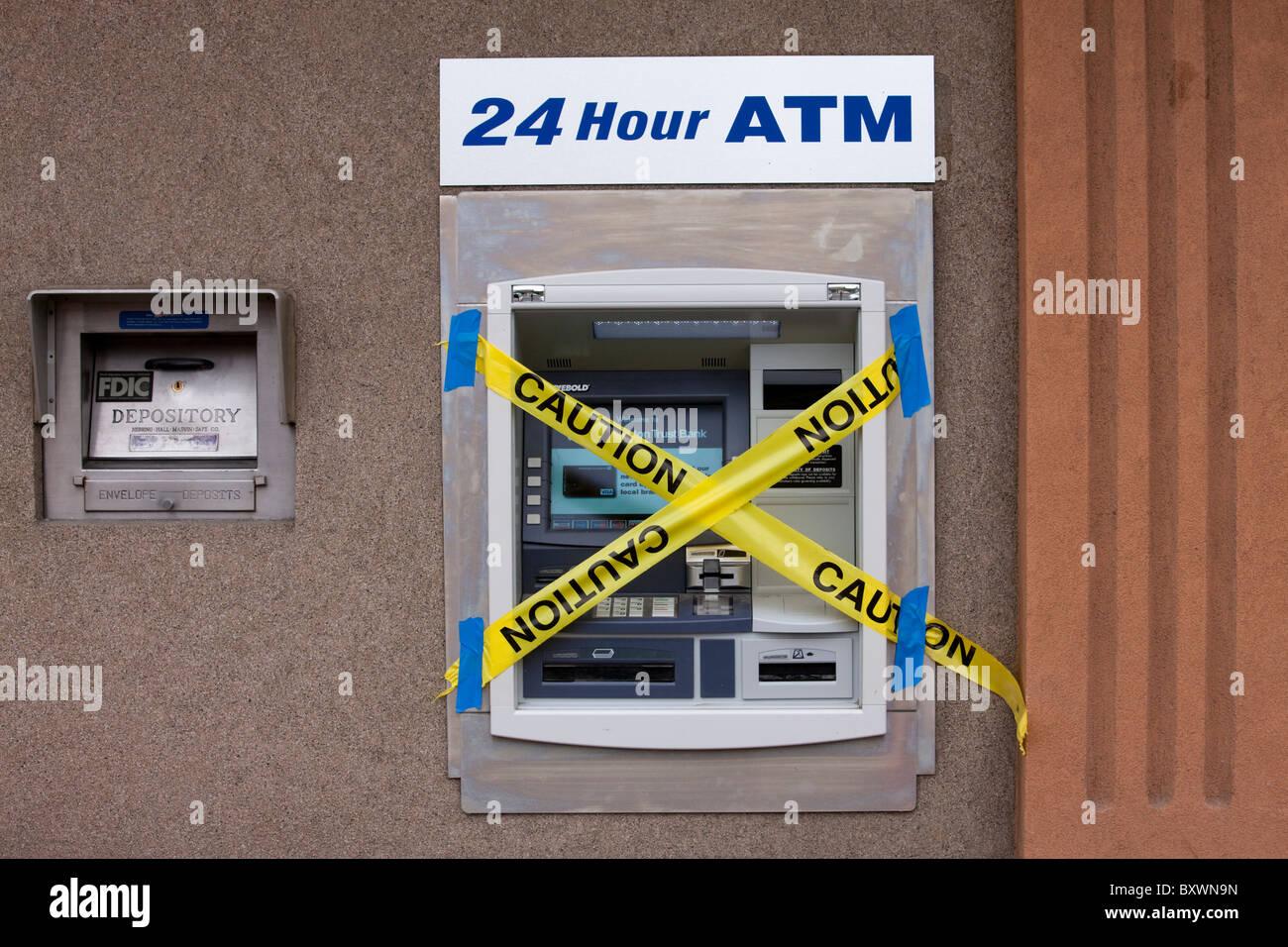 USA, Washington, Ephrata, Bank ATM machine covered with caution tape - Stock Image