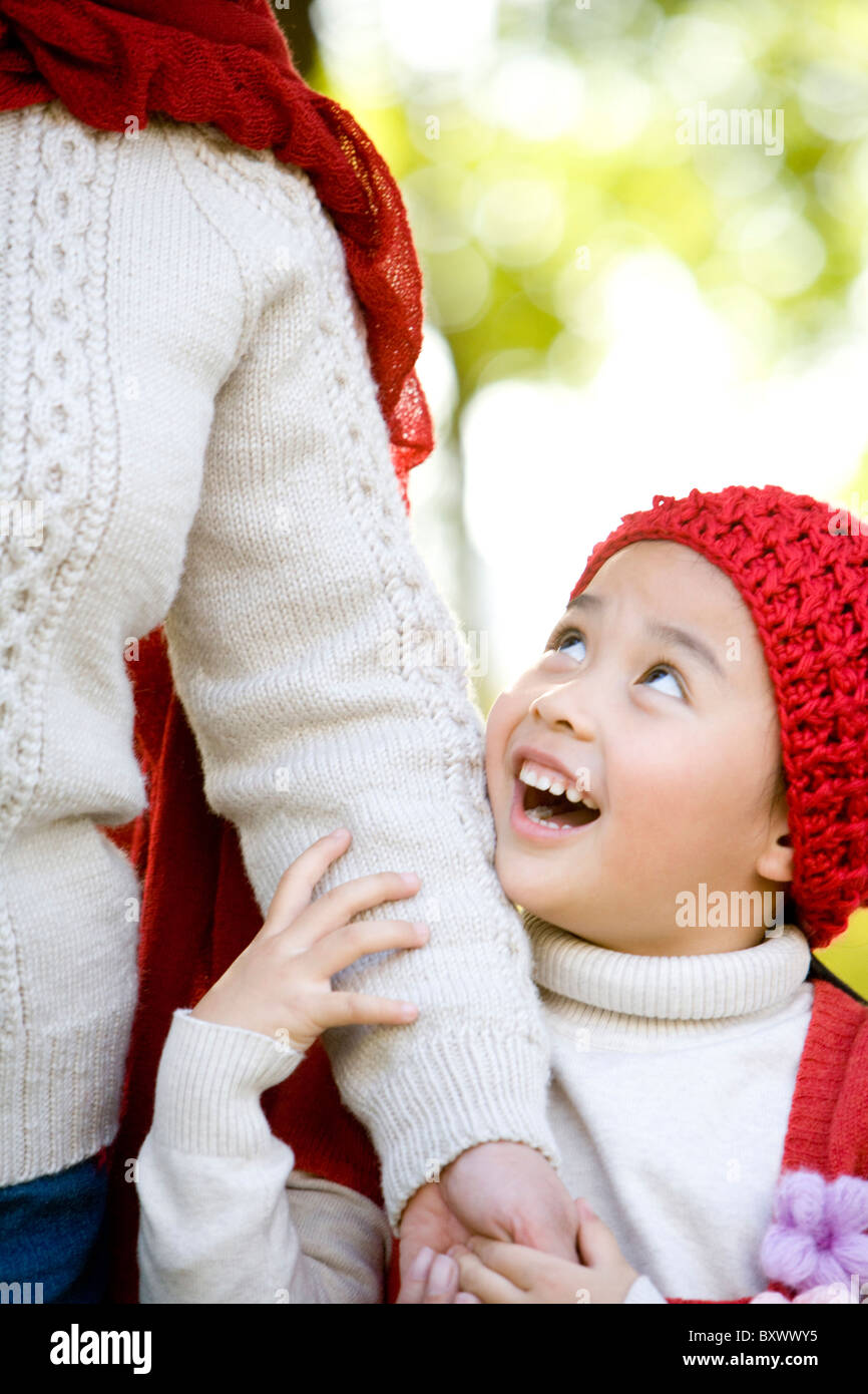 Grandmother and Granddaughter Enjoying a Park in Autumn - Stock Image