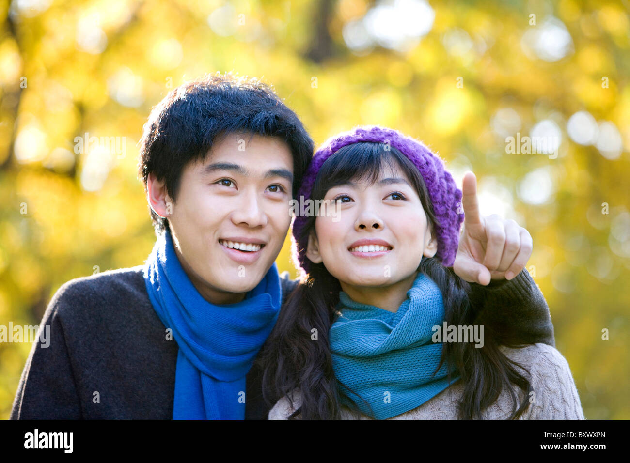 Young Couple Enjoying a Park in Autumn - Stock Image
