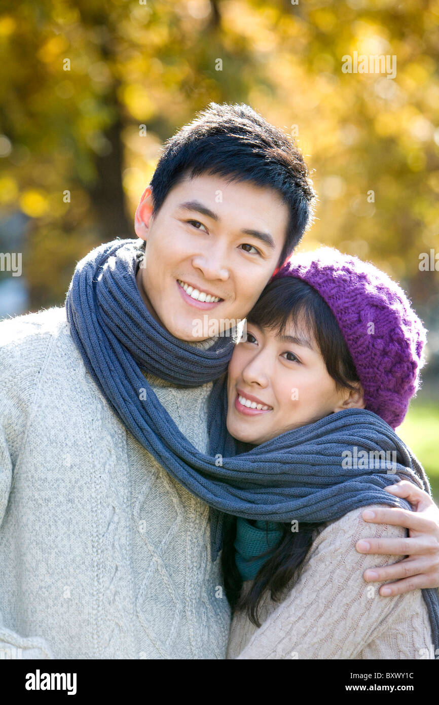 Young Couple Wrapped in a Scarf Stock Photo