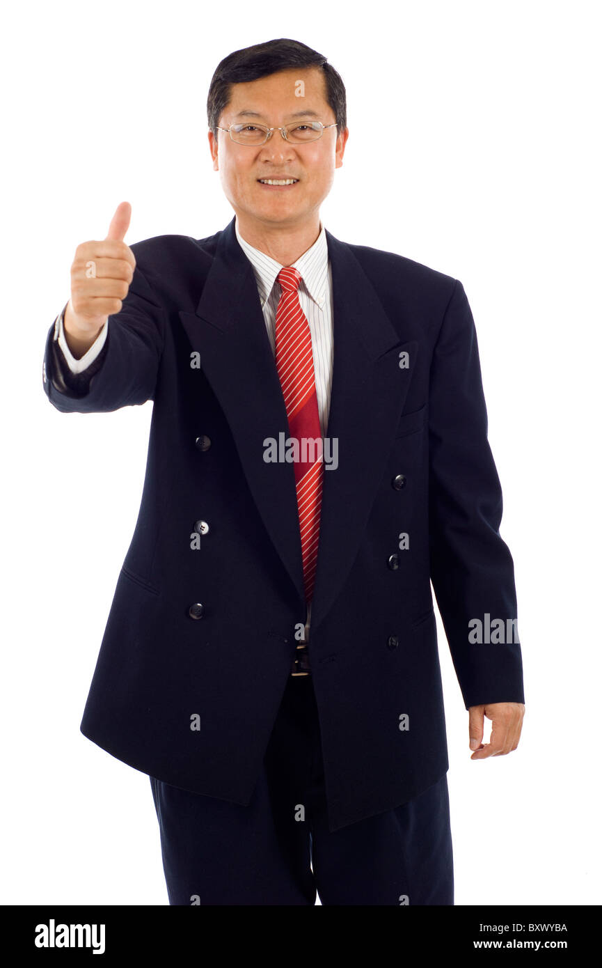 Senior Asian business man with thumbs up isolated over white background - Stock Image
