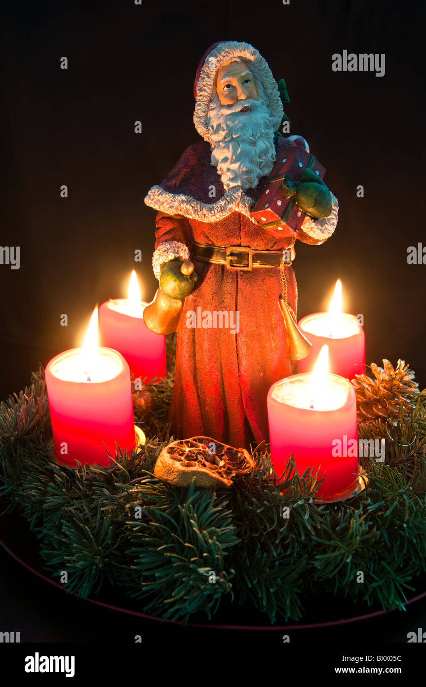 Christmas Advent Wreath With Burning Candles And Santa Claus