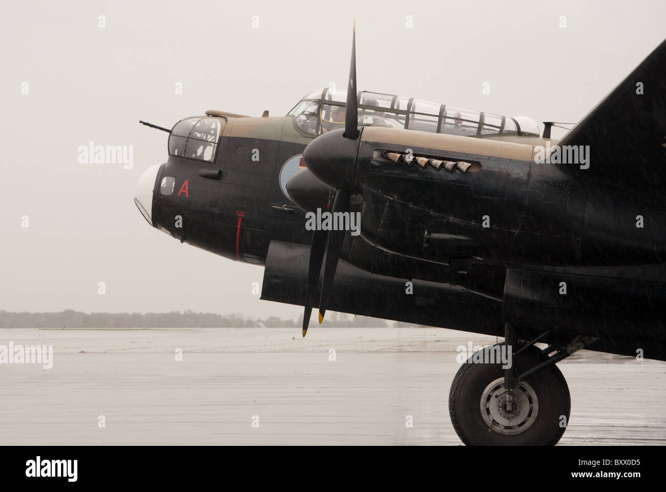 The Avro Lancaster X of the Canadian Warplane Heritage Museum being readied for take off in Hamilton Ontario, Canada. - Stock Image