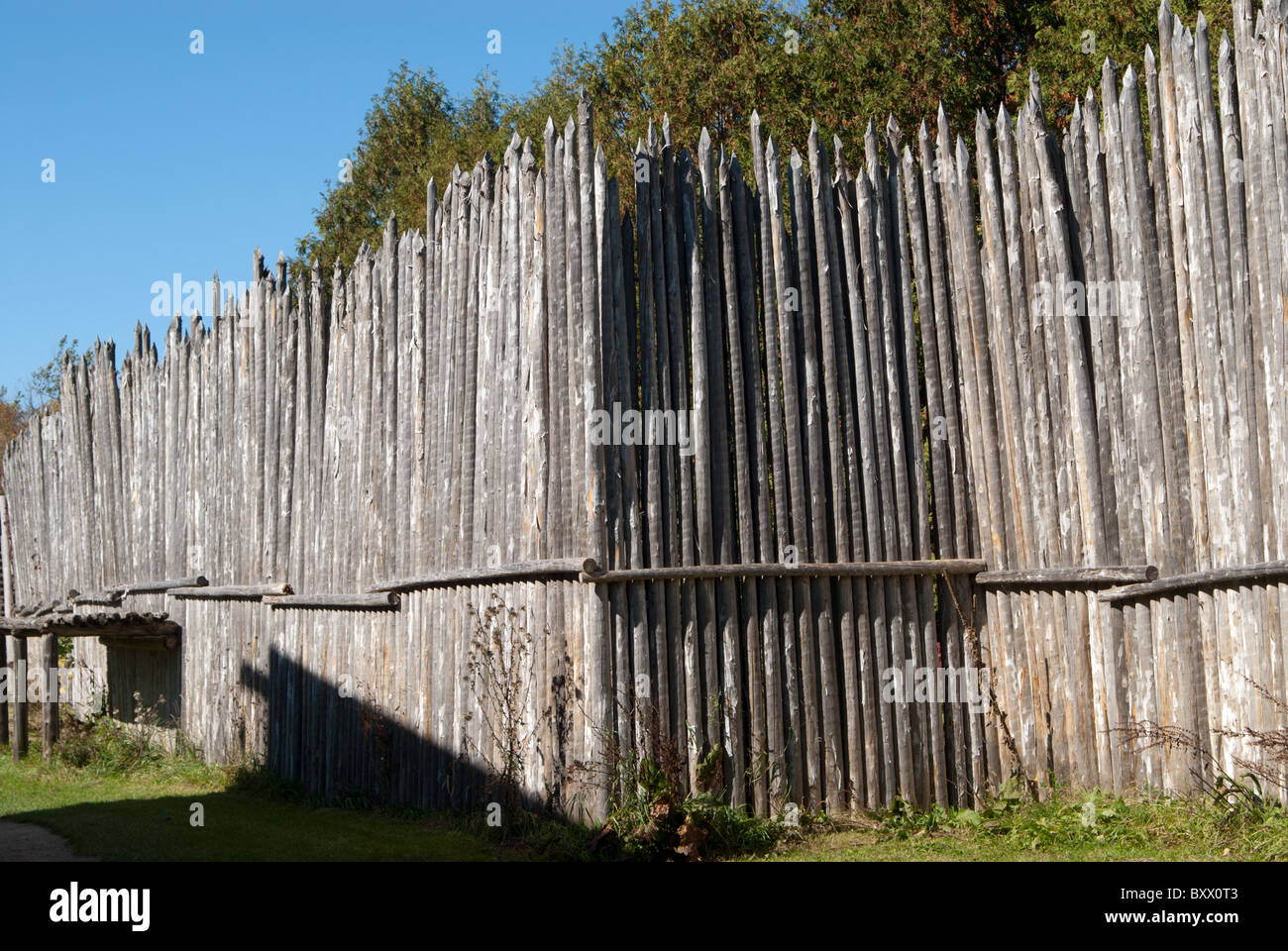 A wooden palisade fence at the museum of Sainte-Maire Among the Hurons, in Midland, Ontario, Canada. - Stock Image