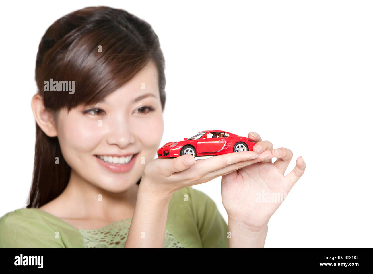 Portrait of Young Woman with Toy Car - Stock Image
