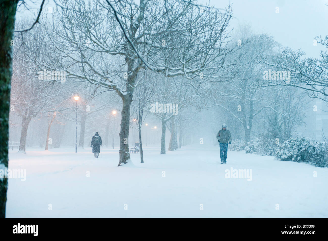 Early morning, people walking in the snow, Aberystwyth Wales UK December 2010 - Stock Image