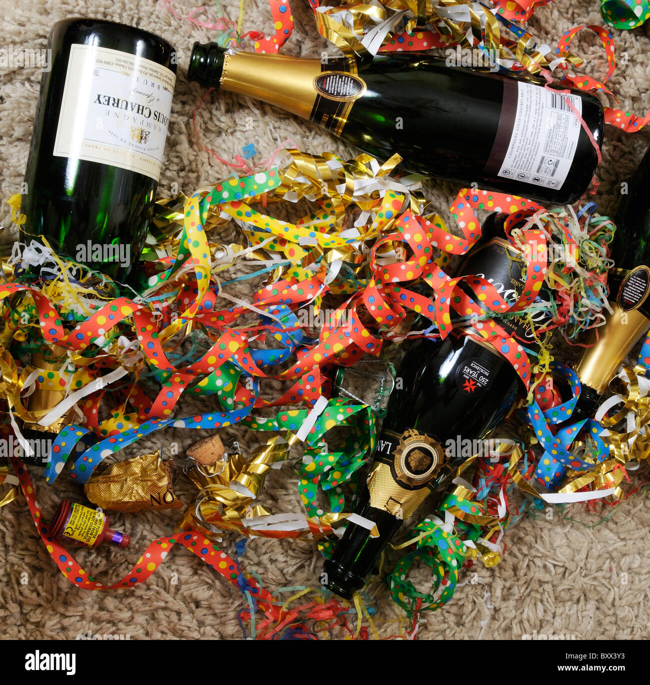Party balloons and Champagne bottles - Stock Image