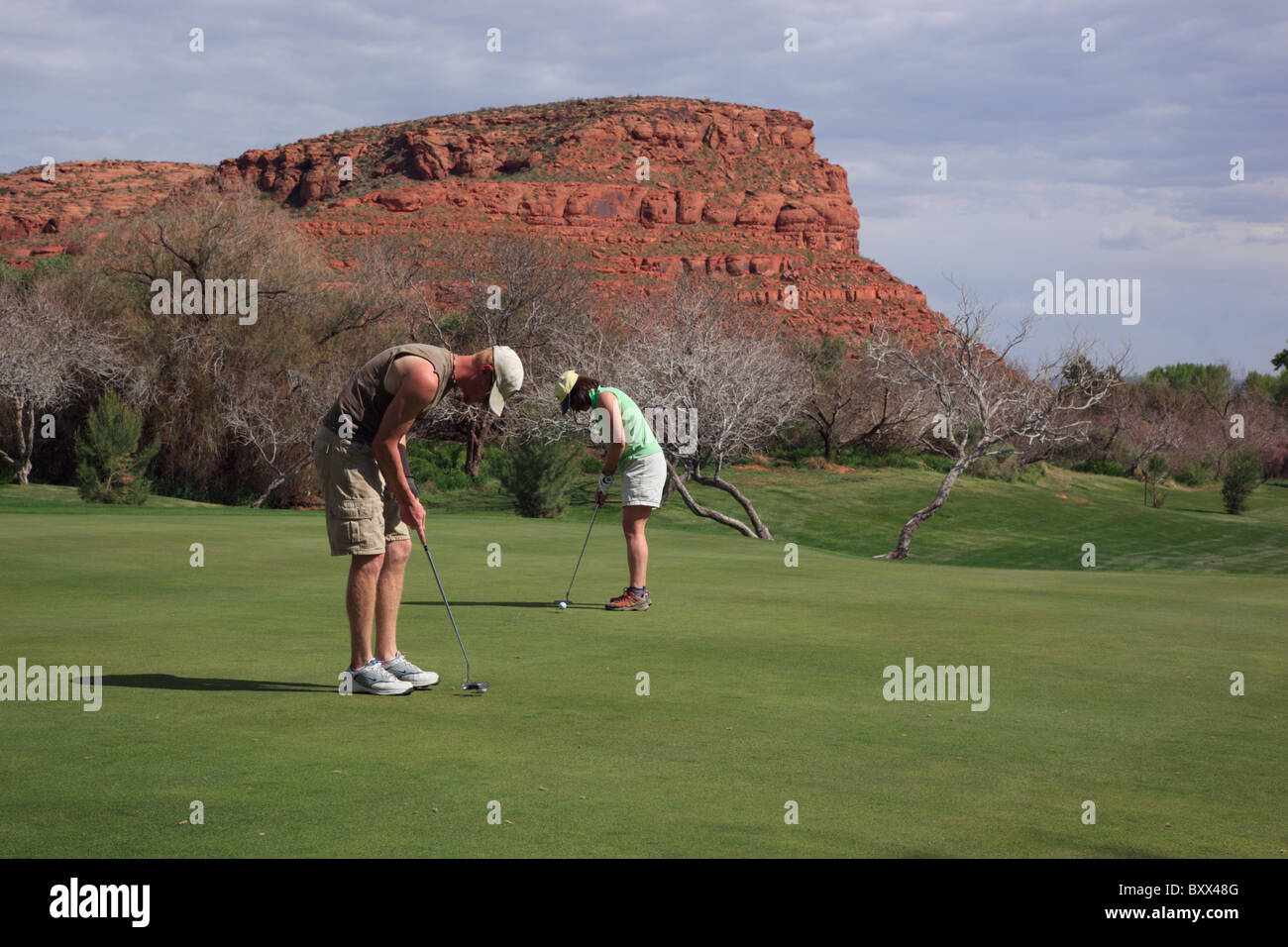 Golfers putting at Dixie Red Hills golf course in St George, Utah, USA. - Stock Image
