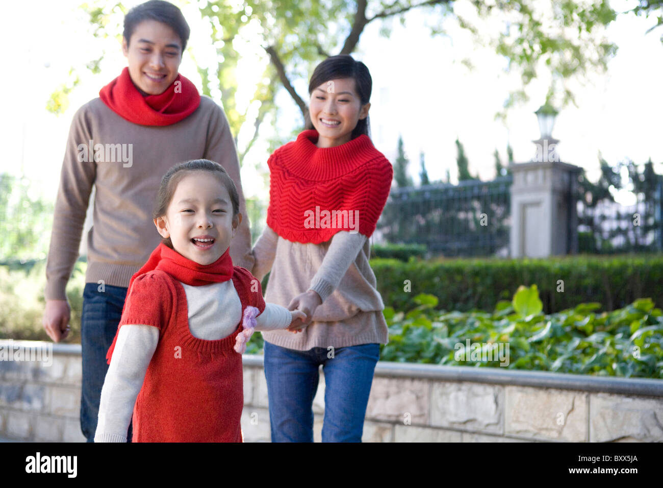 Young Family Enjoying a Park in Autumn - Stock Image