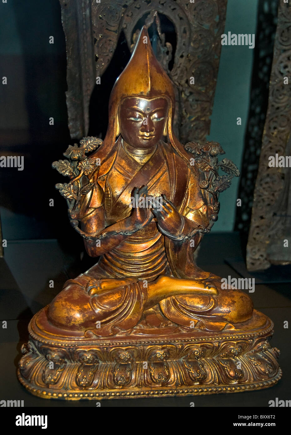 Yellow Hat manner monk Tsongkhapa 14th cent  Tibet Tibetan  Dahai Lama is the head of this group statue 19th cent - Stock Image