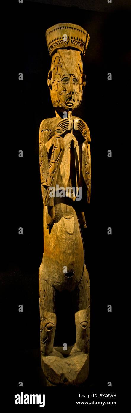 Kamoro Papua New Guinea Indonesia museum pregnant woman - Stock Image