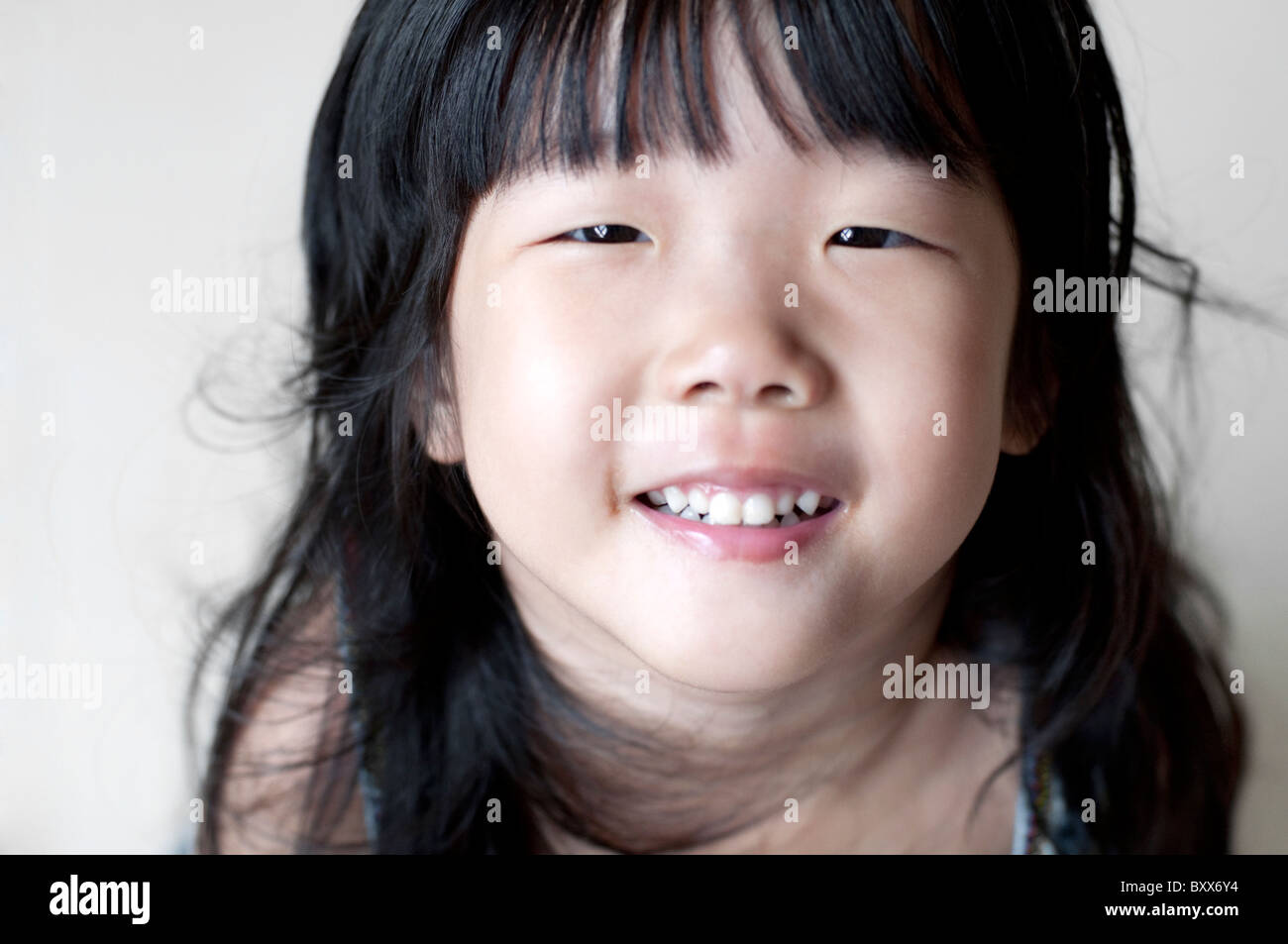 Portrait Of Single Eyelid Little Asian Girl Smiling Looking Up