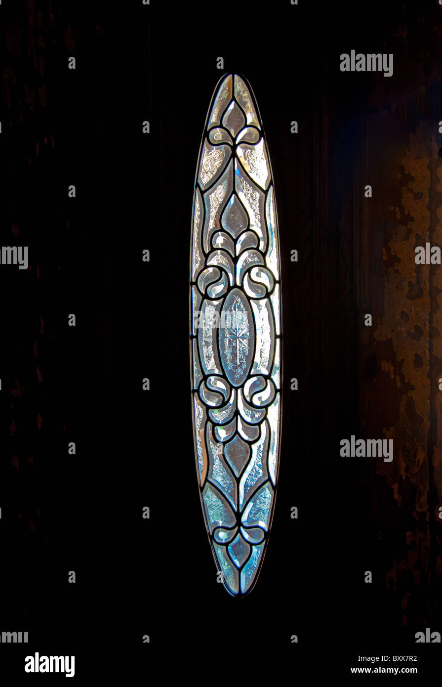 Antique stained glass door panel - Stock Image