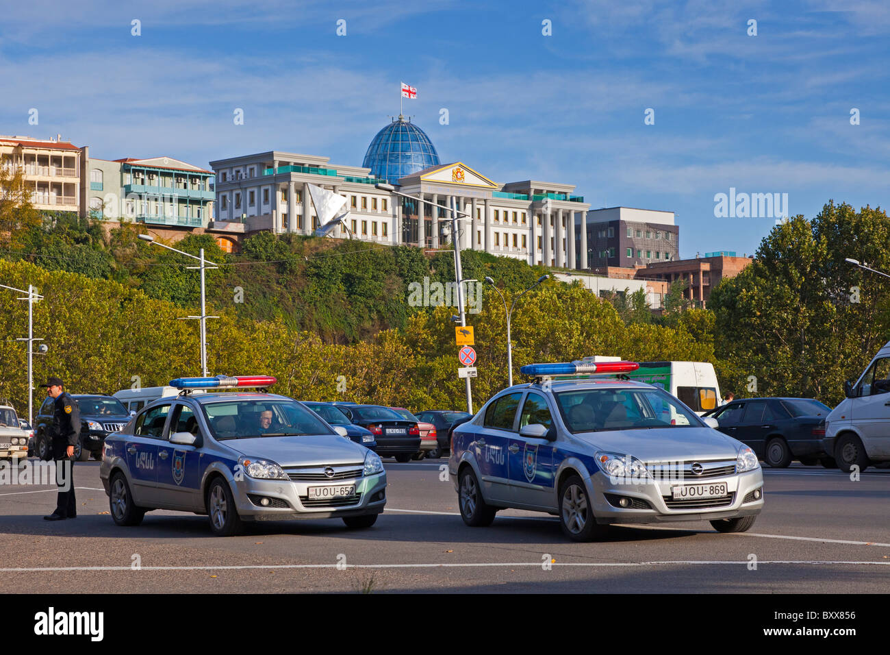 Presidential Palace Tbilisi Georgia designed by architect Michelle de Luci, with two police cars in the foreground. Stock Photo