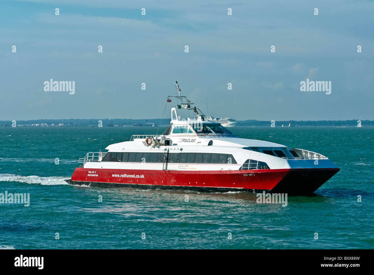 Red Funnel catamaran Red Jet 3 off Cowes in the Solent on the Southampton - East Cowes Isle of Wight route - Stock Image
