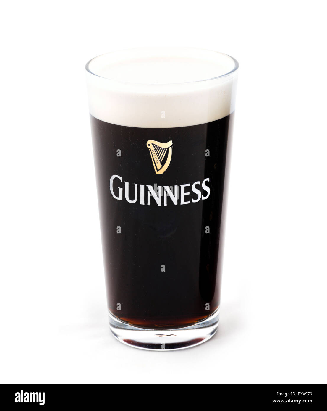 Pint glass of draught Guinness, UK - Stock Image