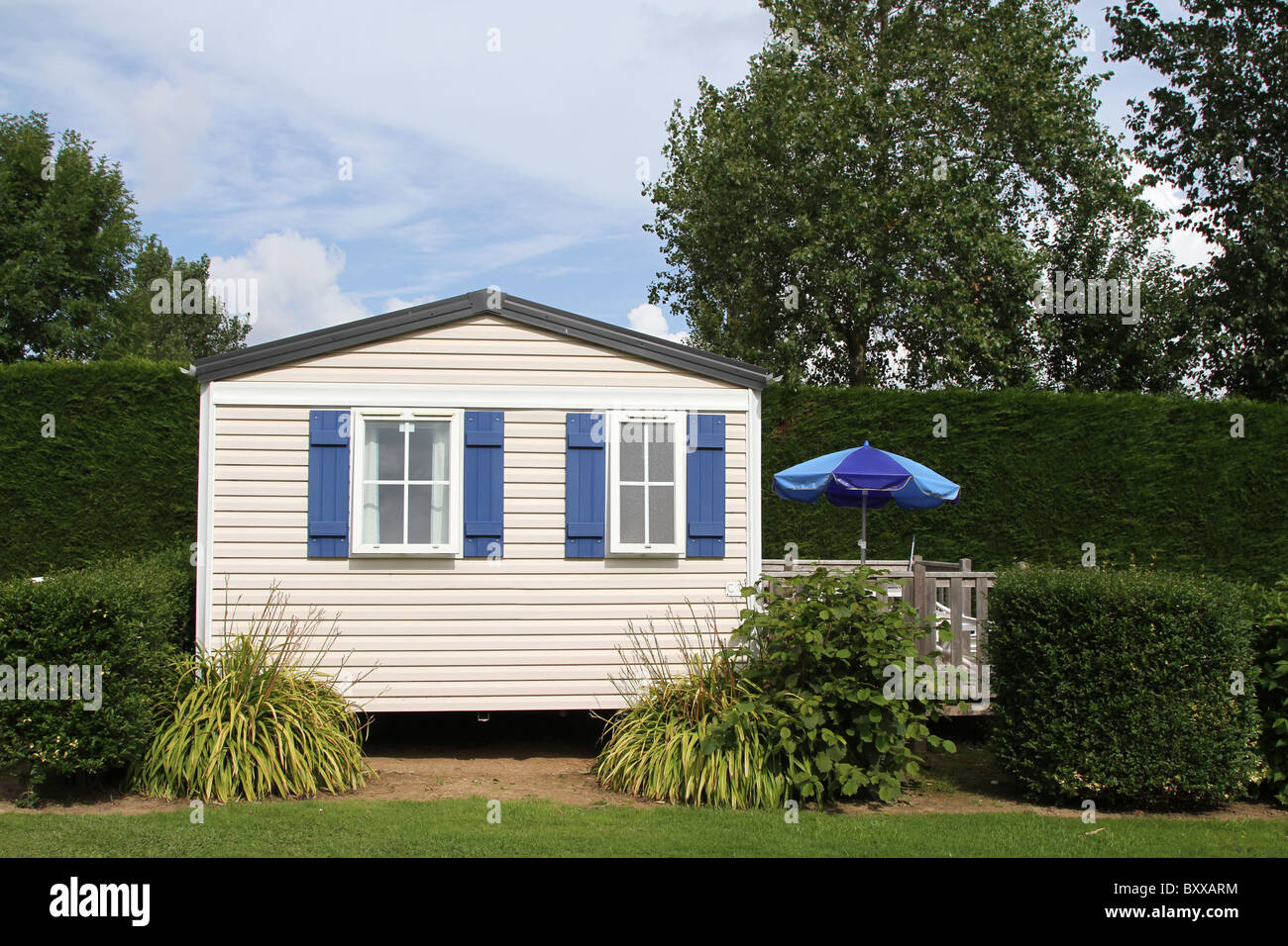 Static caravan holiday home on a woodland caravan park Stock Photo