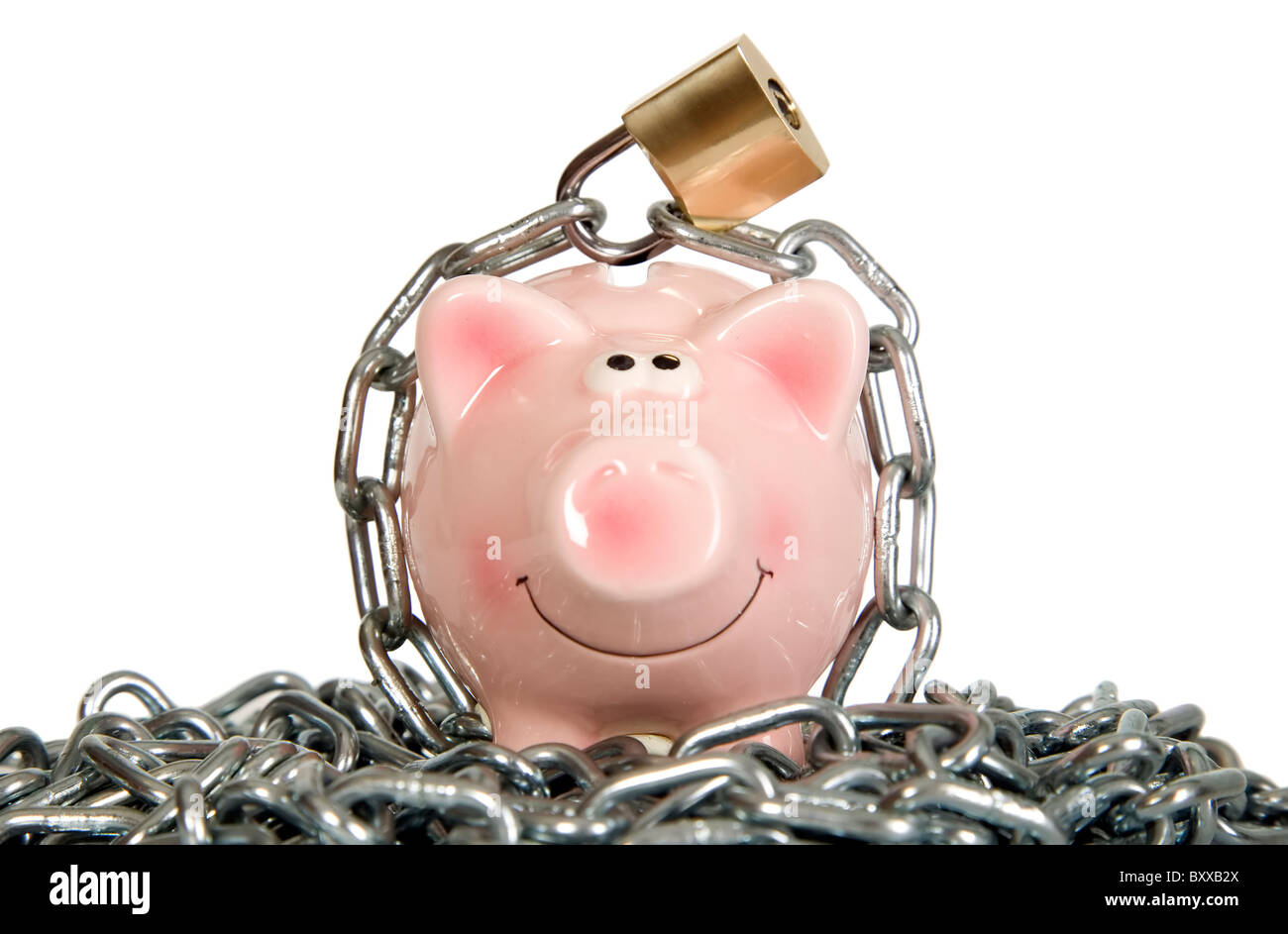 Saving pig is secured with metal chain and lock - Stock Image
