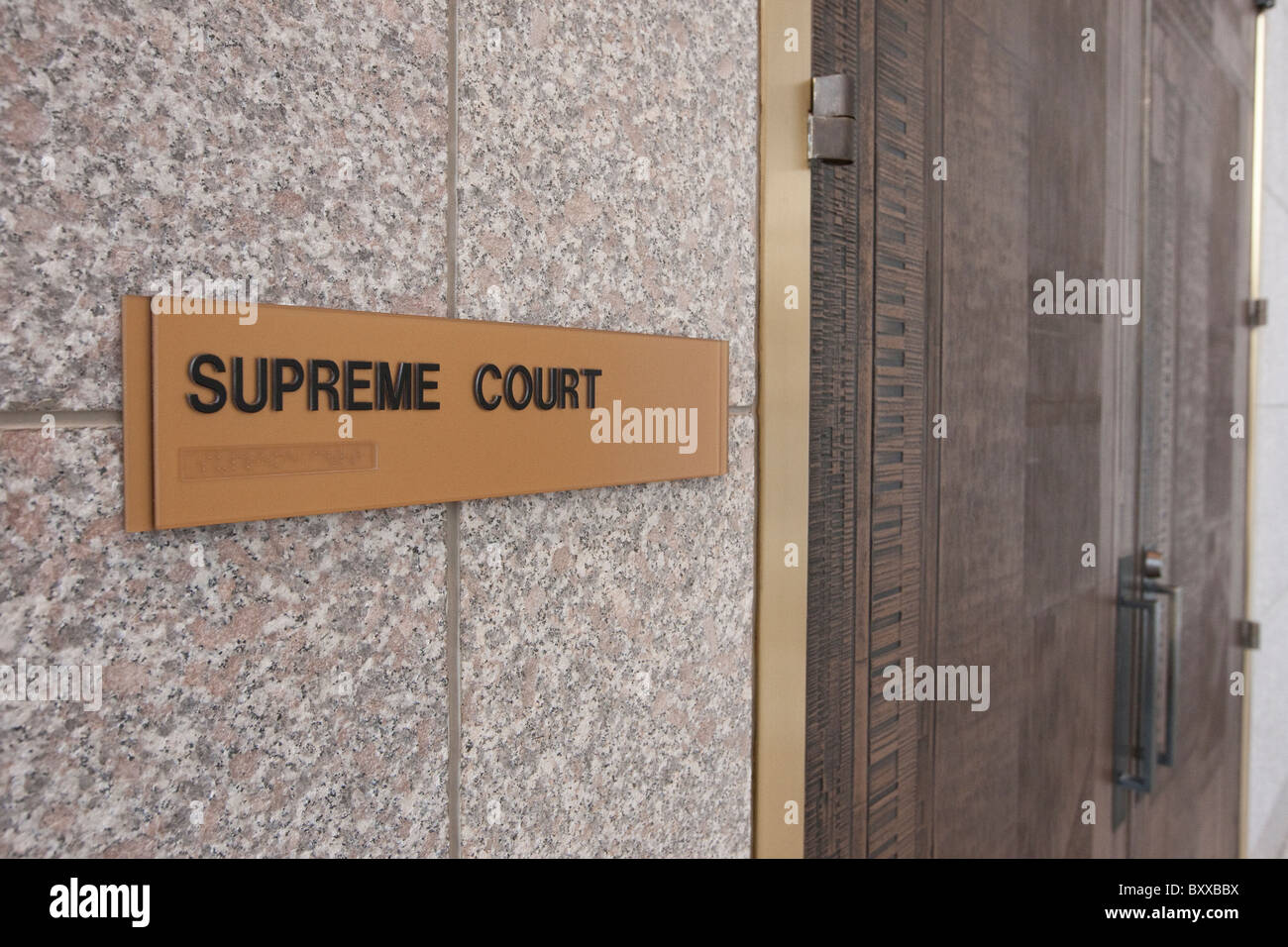 Sign for Texas Supreme Court chamber, written in English with Braille underneath, in the Supreme Court building - Stock Image