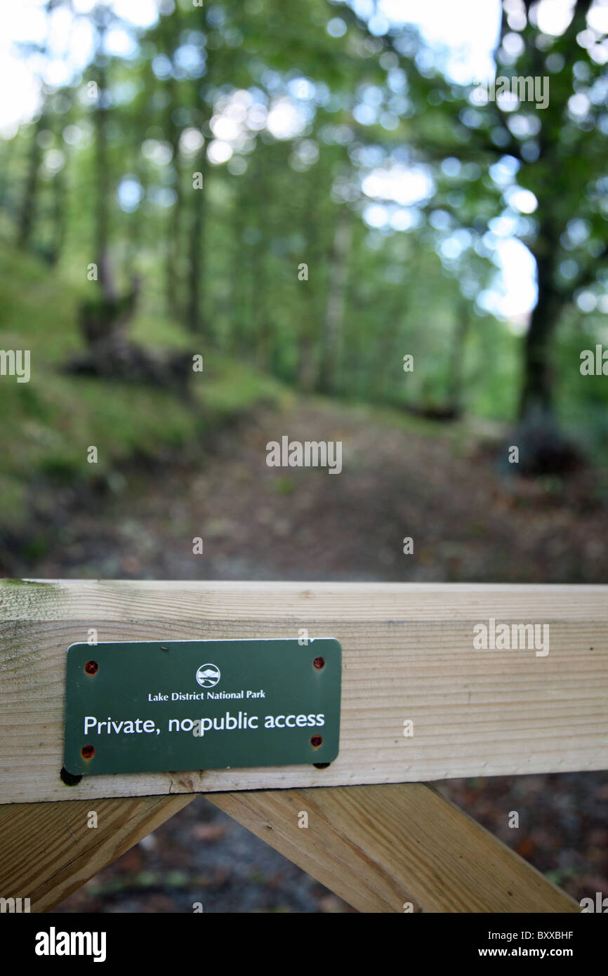 A sign on a gate saying Private no Public Access Lake District National Park - Stock Image