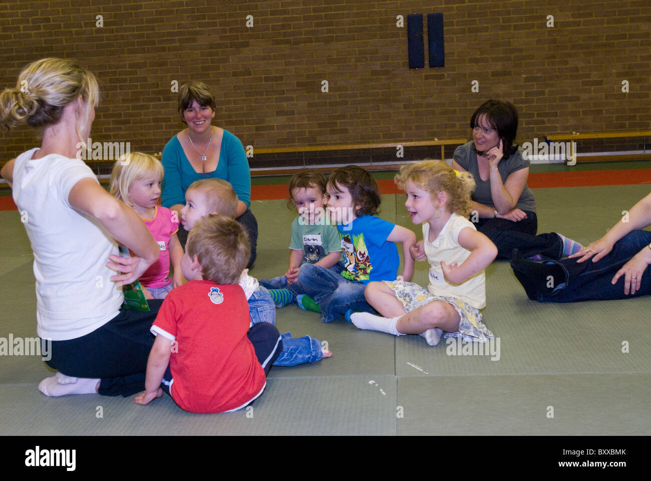 Young children do actions to a nursery rhyme UK - Stock Image