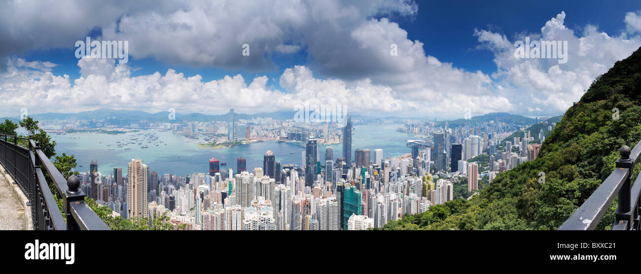 Hong Kong panorama across Victoria Harbour towards Kowloon from Lugard Road, Victoria Peak. - Stock Image