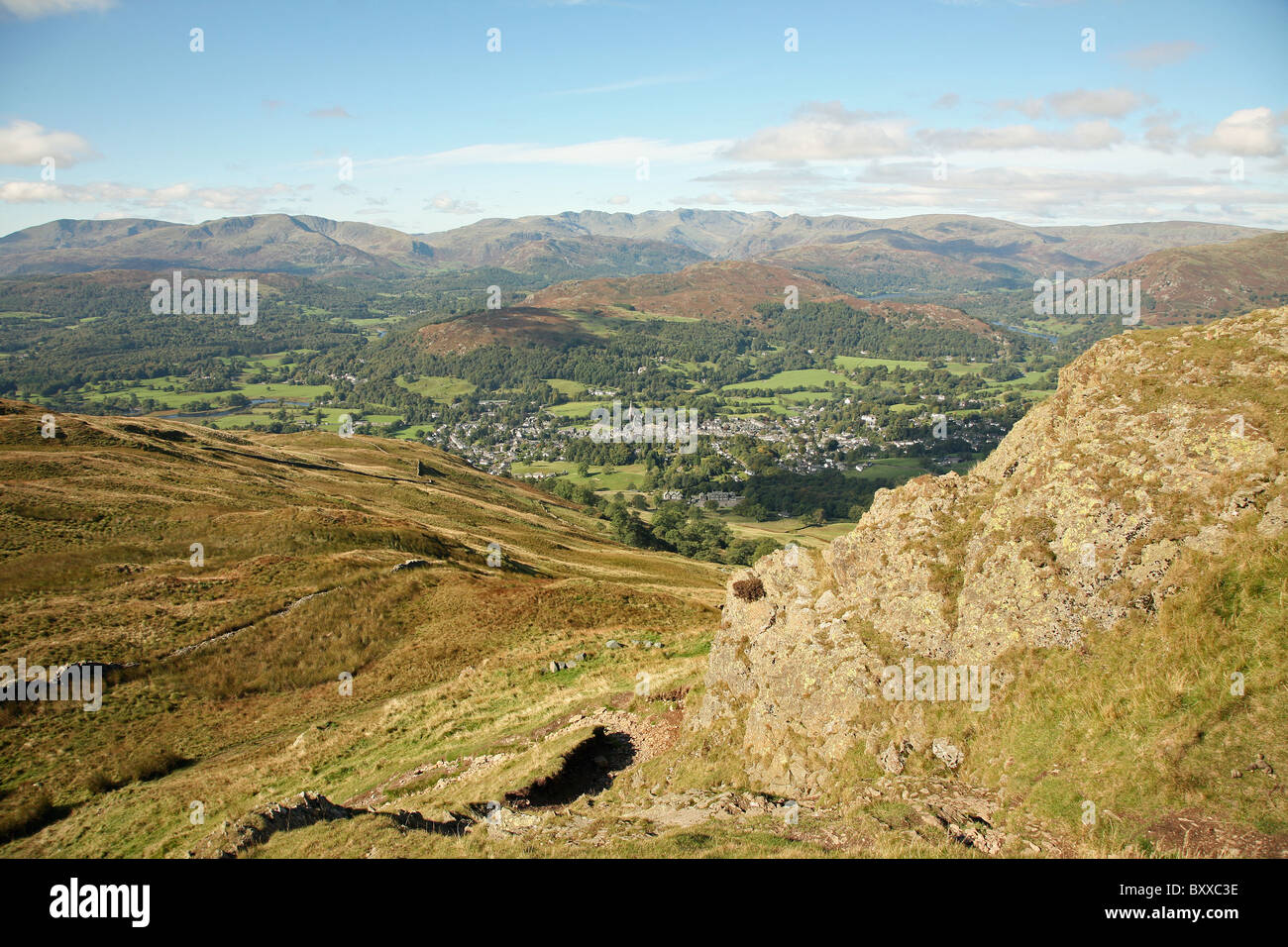 A view from Wansfell Pike overlooking the town of Ambleside in the English Lake District National Park Cumbria England - Stock Image
