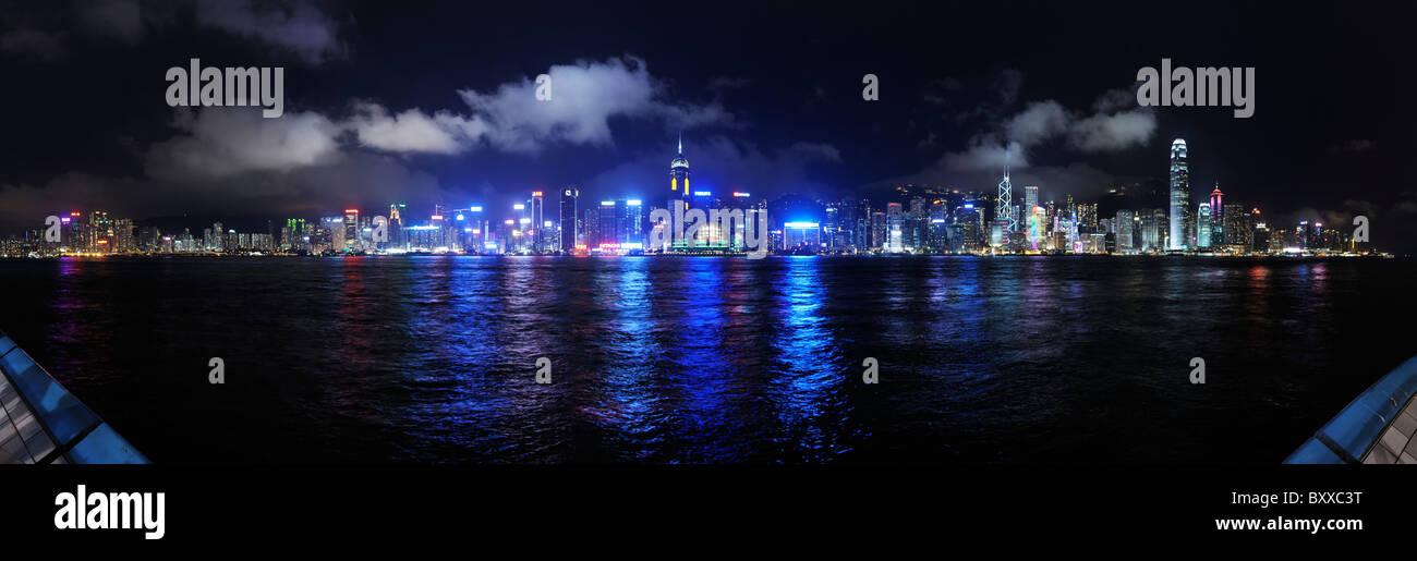 Hong Kong waterfront panorama at night, across Victoria Harbour from 'The Avenue of Stars', Kowloon. - Stock Image