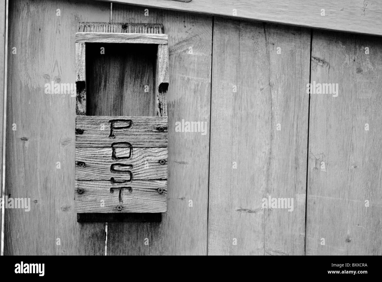 Old postal box on the wooden wall. - Stock Image