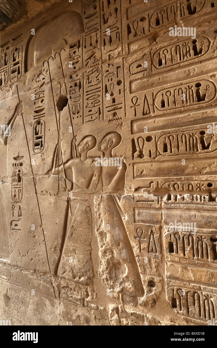 Relief of fan bearers at Medinet Habu , Mortuary Temple of Ramesses III, West bank of Nile, Luxor, Egypt - Stock Image